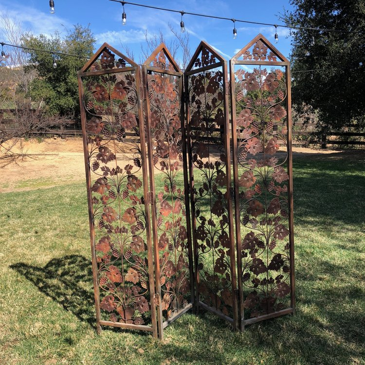 Shabby chic rust grapevine metal quad fold screen. Vintage rentals.