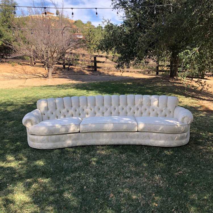 "Pearl   Tufted cream floral couch with three wide cushions. Sleight curve to the shape. Pairs with The Gabor Sisters. 112"" long x 40"" wide x 28"" high. Seat at 16"" high.. Great couch for photo ops."
