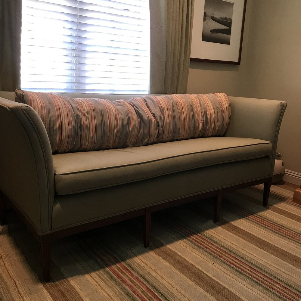 Sleek sage green mid century modern couch for rent for wedding lounge area.
