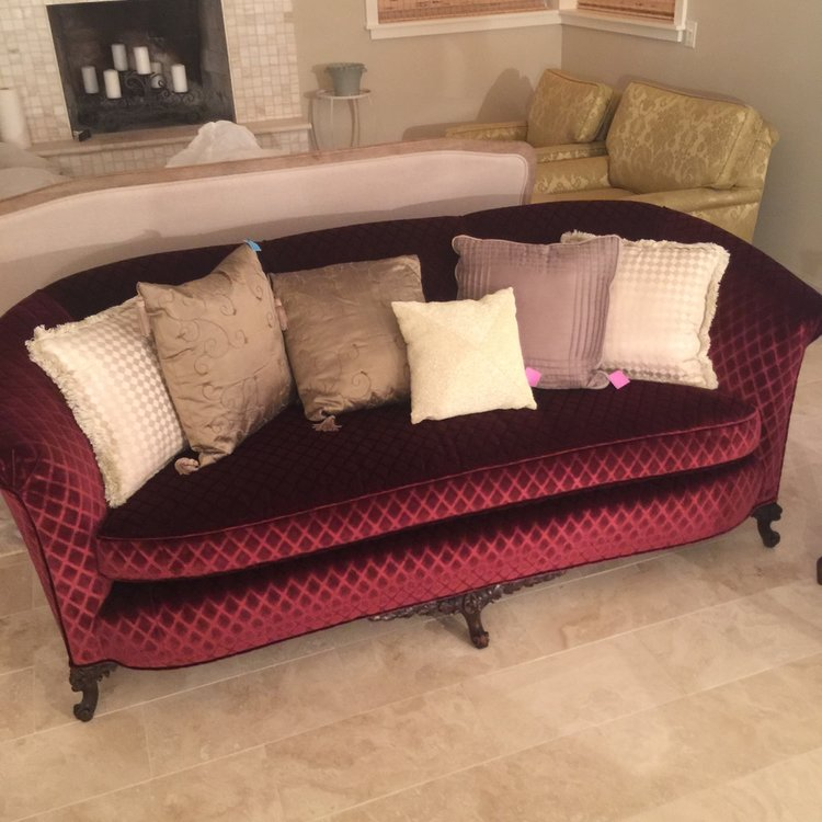 "Ruby   Recently covered in vintage fabric, this couch is Marsala velvet with a diamond pattern. The wood on the bottom has a sculptured pattern on it. It has a camel back with rolled arms. Great piece for photos. So dang cute! 36"" wide x 82"" long x 28"" high."