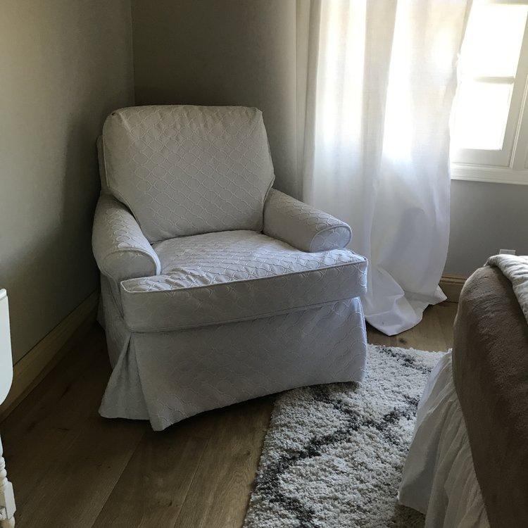 "Edith   True white, circular geometric, fabric chair. Loose back with T-cushion seat. box pleated corners. 31"" tall x 37"" wide. Seat 33""x40""."