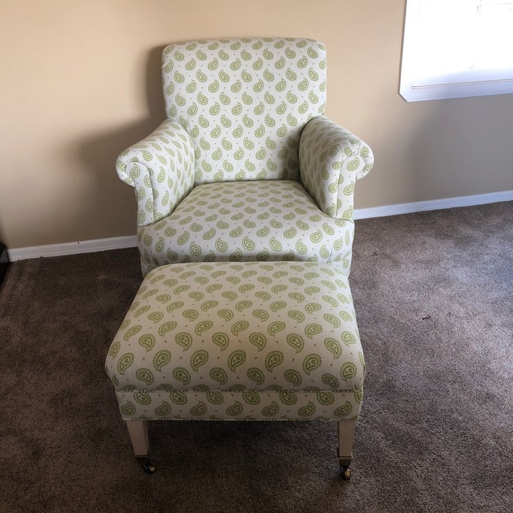 """Zoe  Apple green paisley linen club chair with wooden legs with brass rollers. Rolled back. Seat 23"""". Overall 36"""" x 37""""tall. Matching Ottoman with brass roller legs. 24"""" x 19"""" rectangle. 17"""" tall."""