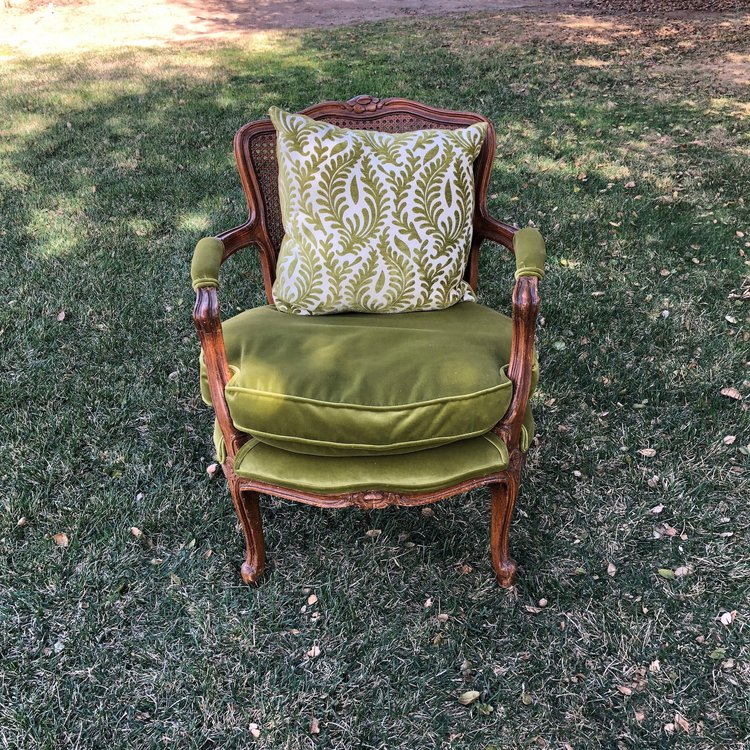 """Penelope  Green velvet Bergere chair with cane back and loose cushion. Add a pillow for a different look all together. Seat 23""""x18"""". 30"""" tall."""
