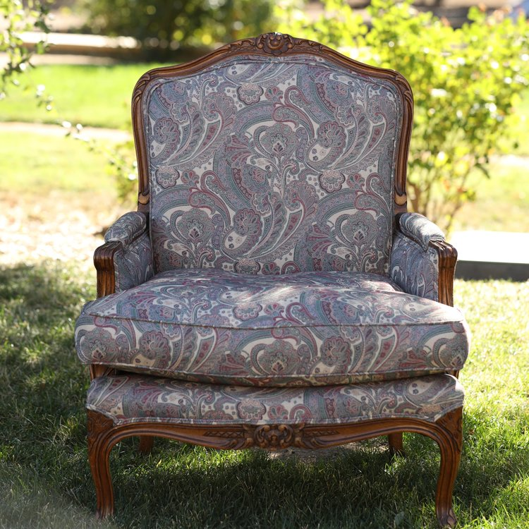 """Courtney   Paisley Bergere with walnut wood floral trim. Solid back. Navy, burgundy, green, and beige. Seat 29"""" x 24"""". 37.5"""" tall. We have two of these."""