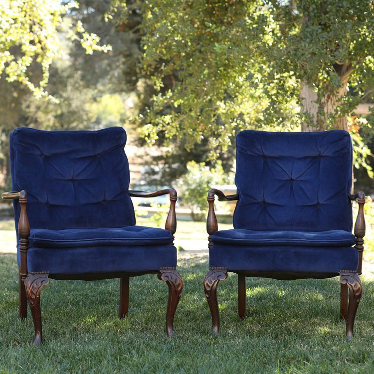 """The Thompson Twins   Navy blue velvet chairs, with wooden arms. Seat 24""""x28"""" by 35"""" tall. Great pair for a sweetheart table."""