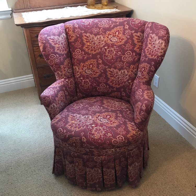 """Delilah   Petite wingback chair with a round seat. Pleated ruffle around the bottom of the chair. Wine pattern printed cotton fabric. 34"""" tall x 32"""" wide."""