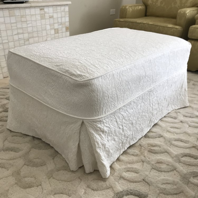 """Del  Cream textured linen ottoman. Great as a coffee table with or an extra seat in a lounge area. 42"""" x 25"""" rectangle. 18"""" tall."""