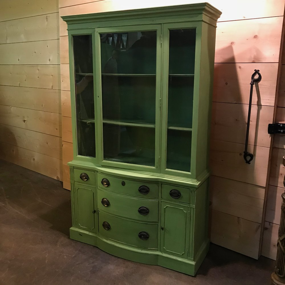 "Olive   Vintage china cabinet chalk painted in sweet pea green. Three shelves with a glass door that opens. Five drawers and two cabinets. 69"" tall x 40"" wide x 13"" deep."