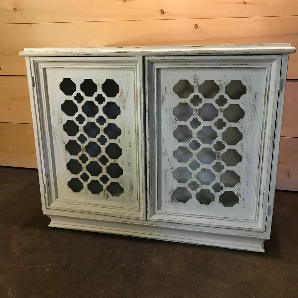 "Kaye   Darling distressed white with flecks of gold leafing showing through miniature buffet. Two doors that open to a useable inside shelve. 36.5"" wide x 18"" deep x 29"" high."