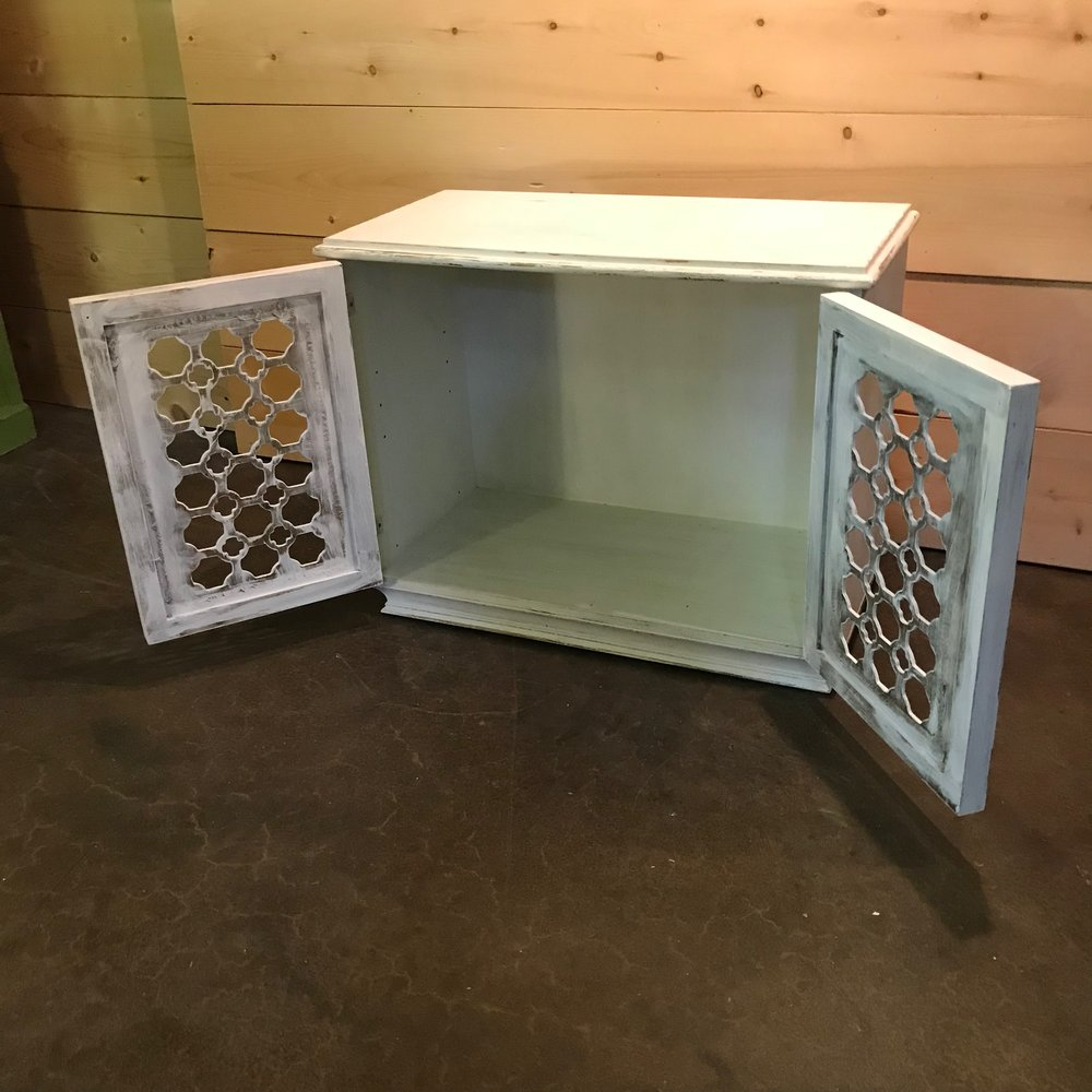Hollywood glam miniature buffet with doors that open. White with gold leafing.
