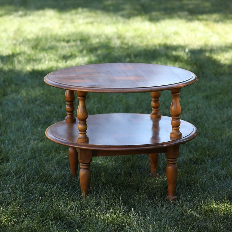 "Cora   Wooden, round, two shelf, accent table. Decorative spindle legs. Great for a cake or dessert table. 28"" round by 23"" high"