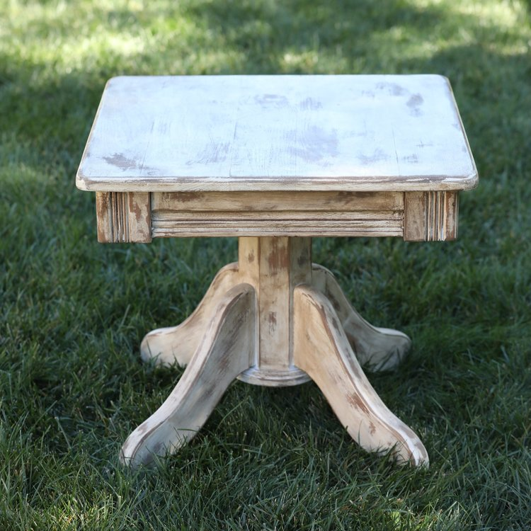 "Louis   Wooden, white, distressed accent table. 23.5"" square by 21"" high."
