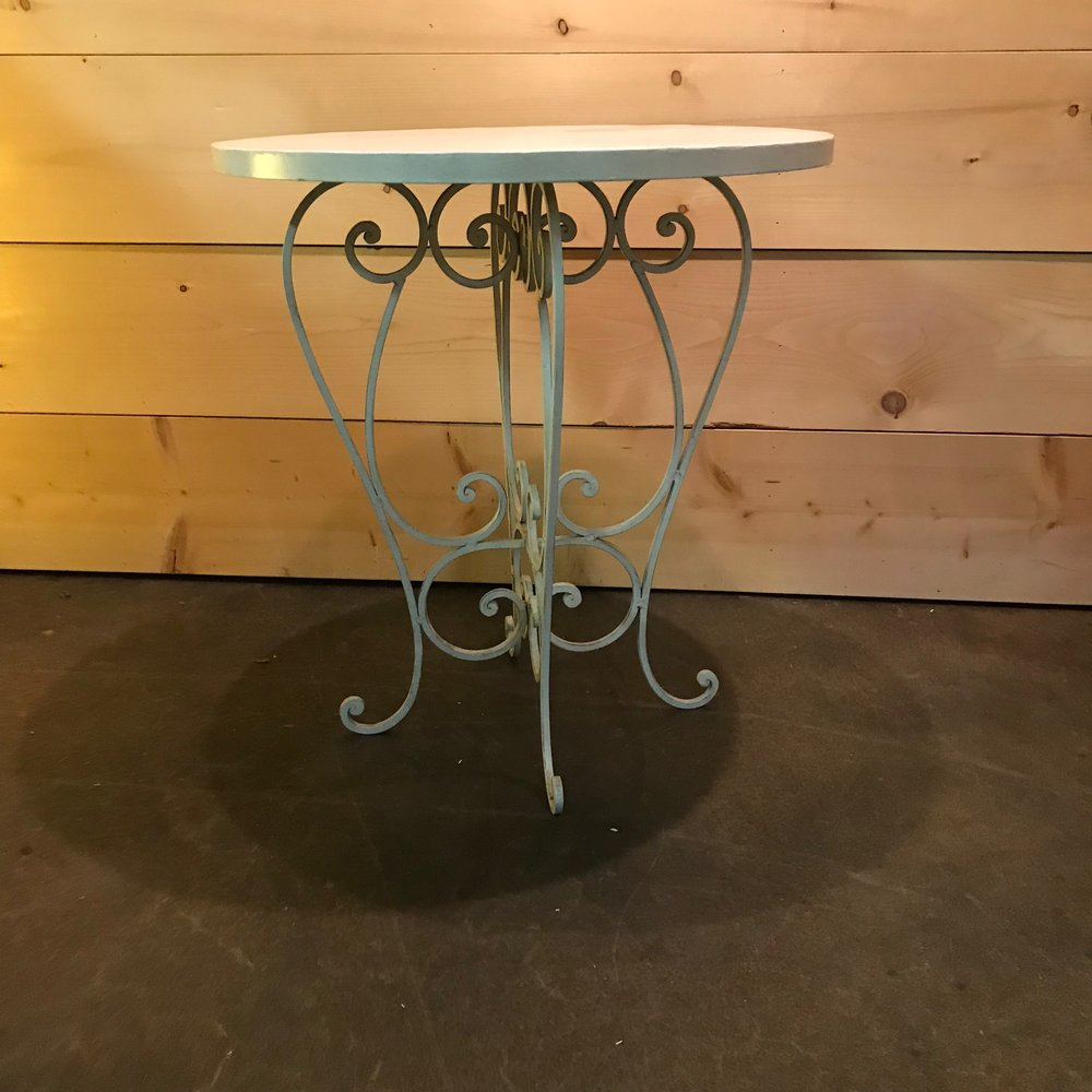 "Justin   Round white metal table with elaborate scrolled legs. Perfect to showcase your wedding cake or to use as a sweetheart table. 30"" tall x 28"" round"