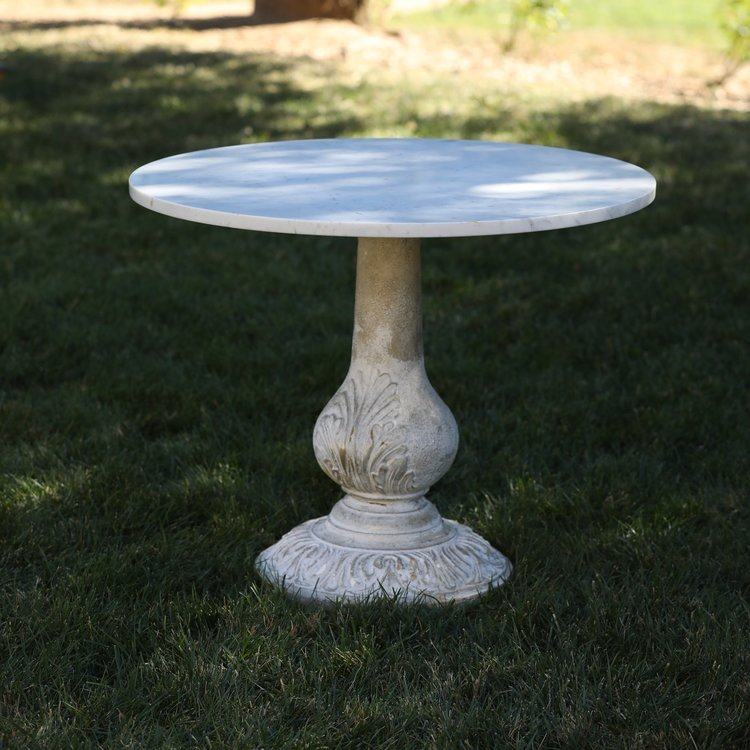 Michelle   Marble top round table with a cement pedestal base. Great for a sweetheart table or a cake table. Measures tall x round.