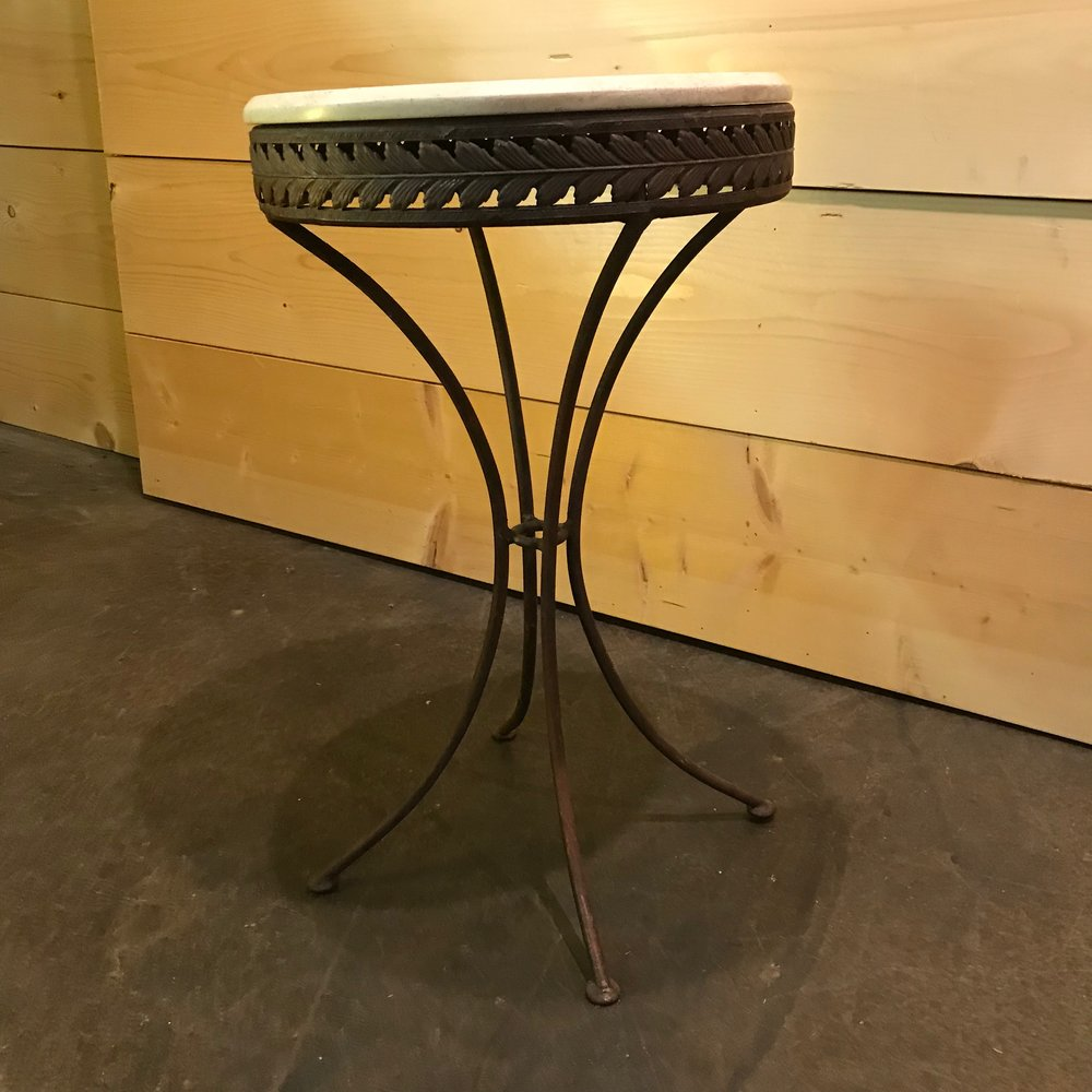 "Roscoe   Heavy metal base with scrolled legs. Round stone table top. 27"" tall x 16.5"" round."