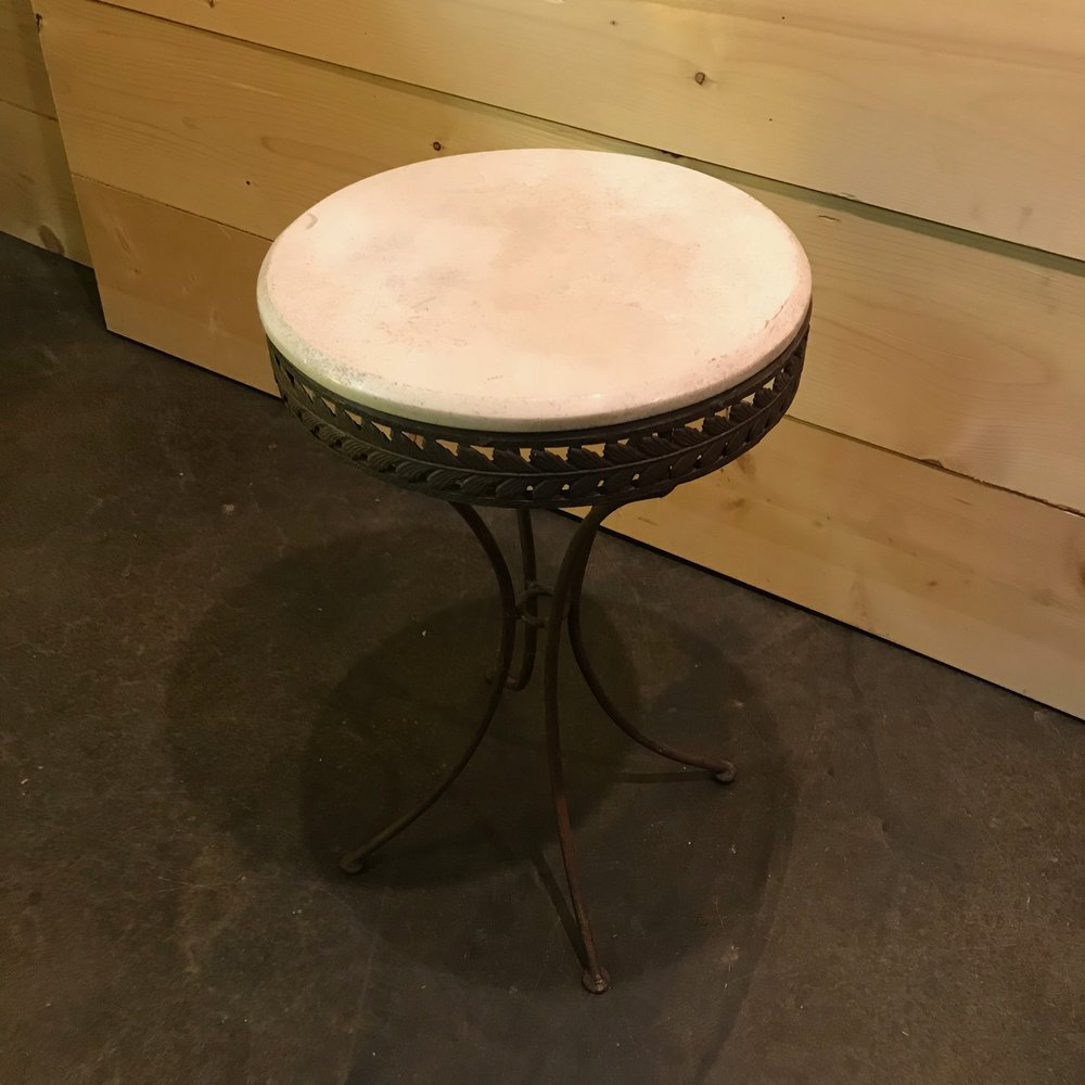Metal base stone top round accent table. vintage rentals.