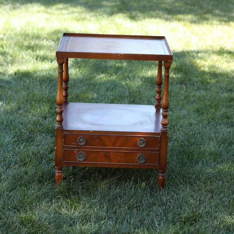 "Olivia   Wooden, two tiered, leather top, two drawers, 20.5"" square by 27.5"" high."