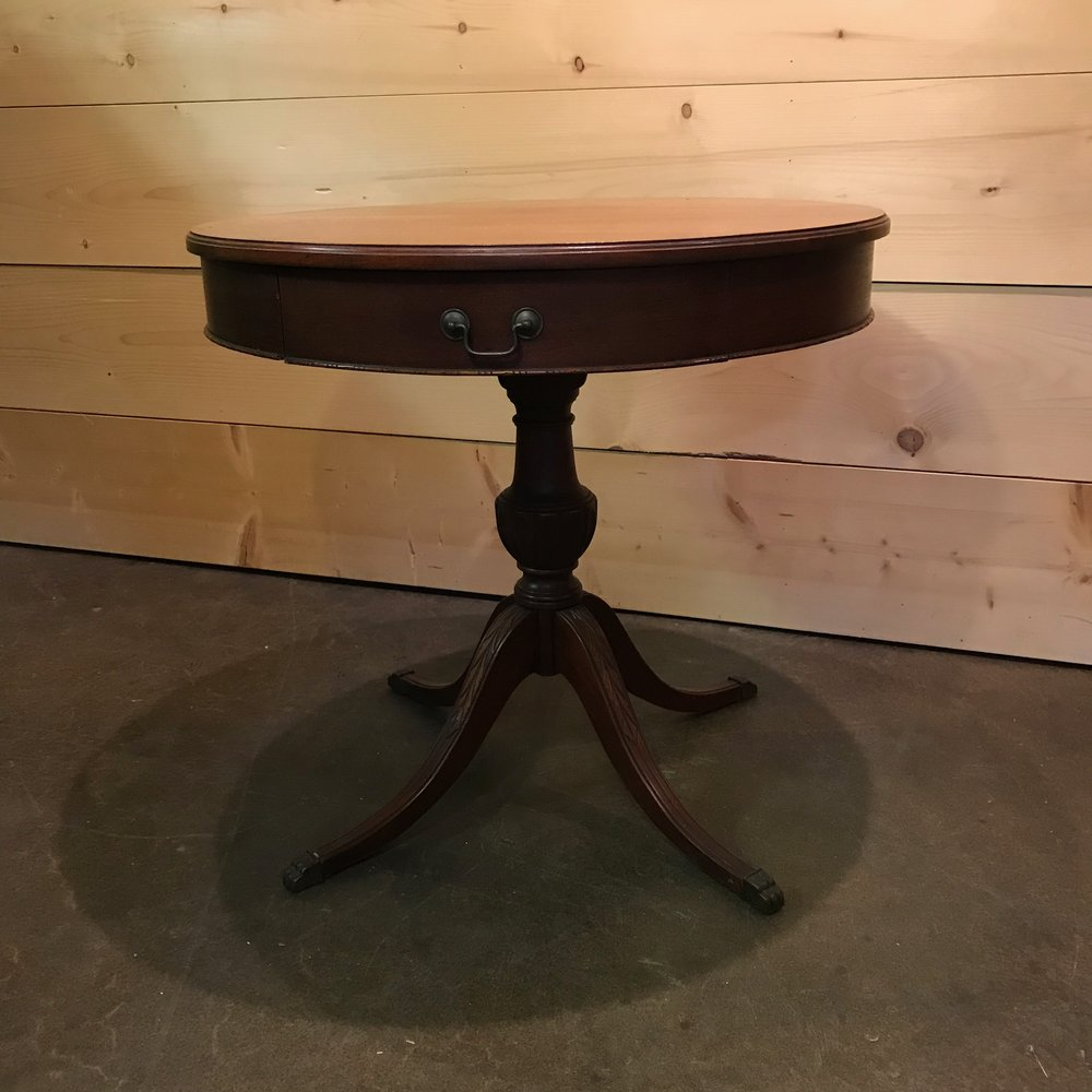 "Jerry   Round side table with center spindle and four legs with a center drawer. 28"" tall x 30"" round."