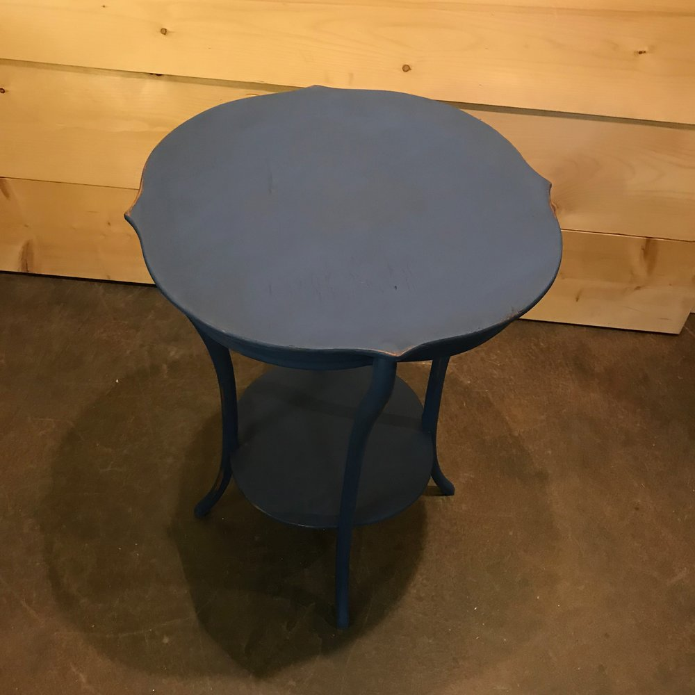 Tall round side table painted with chalk paint navy.