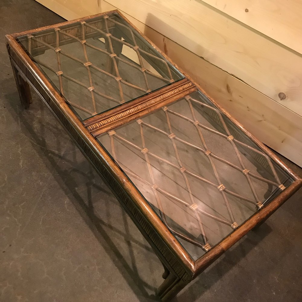 Intricate glass top on the rattan coffee table for rent.