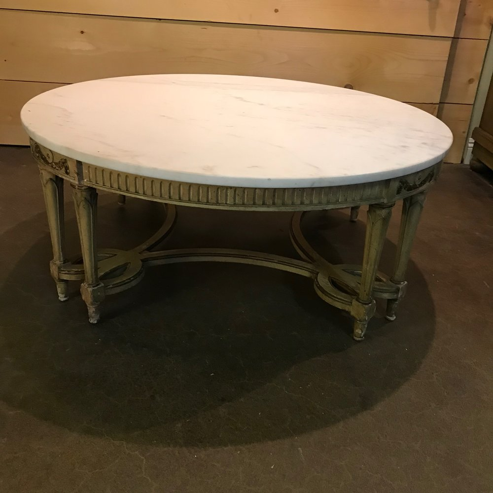 Beautiful marble top on this Hollywood Glam coffee table with gold accents. Vintage rentals.