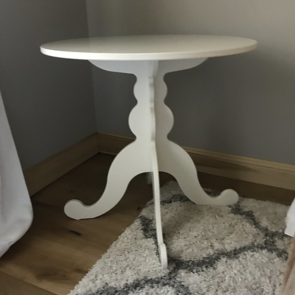 "Gabby   Off white round table with a scalloped feminine base. Glass top. Perfect height for a cake table or sweetheart table. 30"" round x 29.5"" tall."