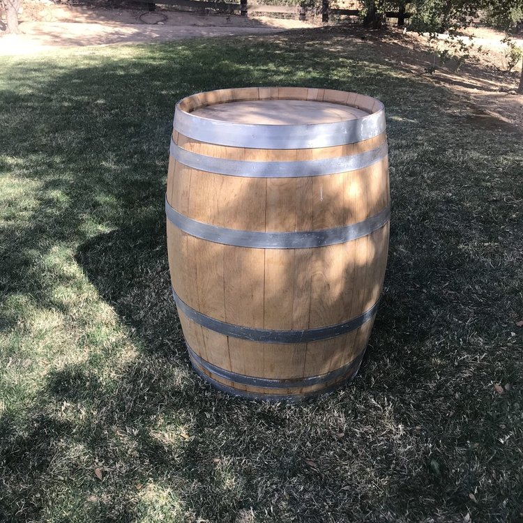 "Wine Barrel   French oak wine barrels with metal bands.  34.5"" high x 23.5"" wide."