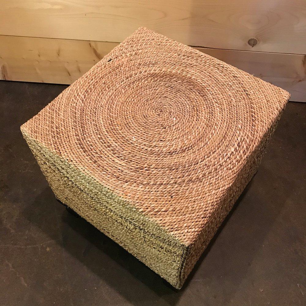 Rattan foot stool to rent.