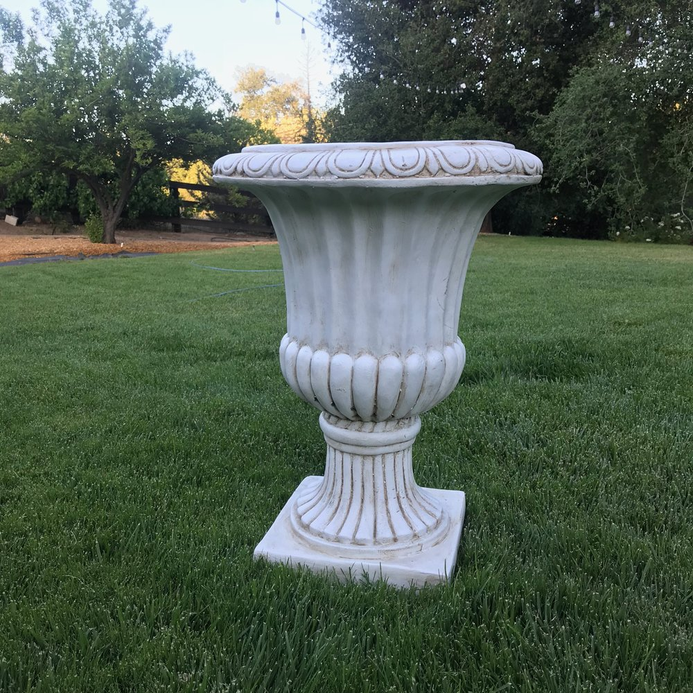 Grecian Urns   Fiberglass pots that look like cement. We have four of these.