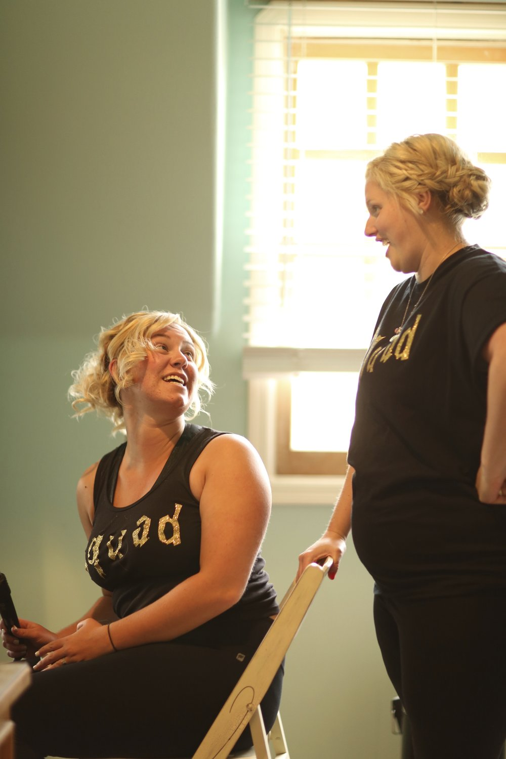 Bridesmaids getting ready for the big day. Each girl is wearing a t-shirt that says squad.
