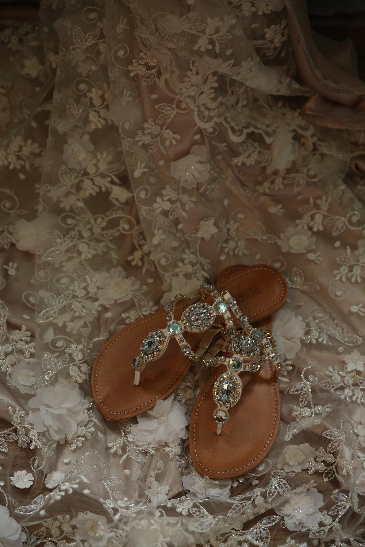 Rhinestone flat sandals worn by the bride on her wedding day.