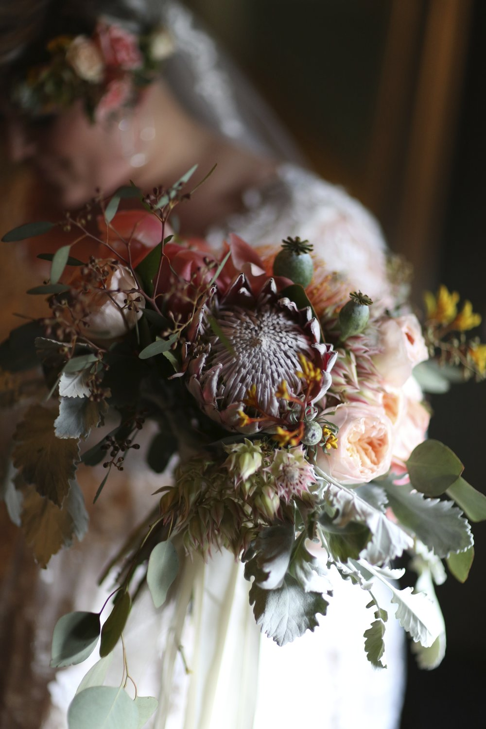 Brides bouquet with king protea and roses and peonies made by Bleudog Floral.