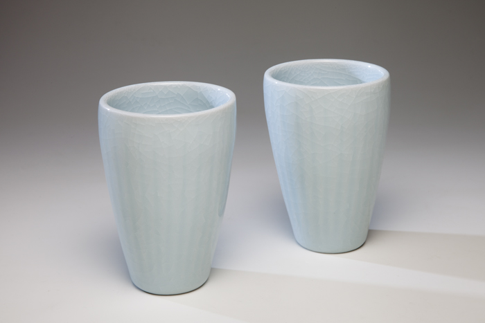 Porcelain striated beakers, 9cm high