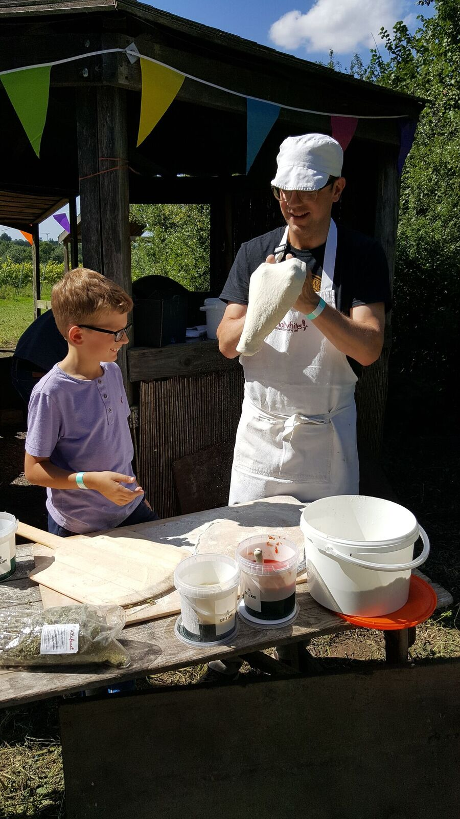 Richard of Holtwhites Bakery (and young apprentice) make pizza in the Vineayard's cob oven