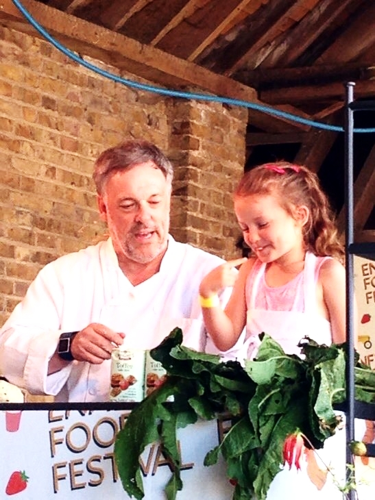 Richard of Wrights Flour make baking simple with a little help from a young member of the audience