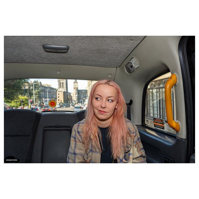 DAY 12 Dayshift Sunday 27 September 2015  82. Off to Work  13:37  Newhaven – Stockbridge  This was Nikki's third time in my taxi (and it's rare to have someone twice). All three  times she was going to work. @nikki.naks . . Can anyone guess exactly where this image was taken? FIRST 3 PEOPLE TO GUESS RIGHT, WILL RECEIVE A FREE BOOK! X🎅🏻 . . FOLLOW MY JOURNEY. X 📷  #edinburghpeople #edinburgh #edinphoto #ig_street #igersedinburgh #portraitpage #instagood  #visitscotland  #instagram #pinkhair #instagramer #canon #canonuk #magnumphotos #igers #streetphotography #streetart #photography #taxi #bestcity