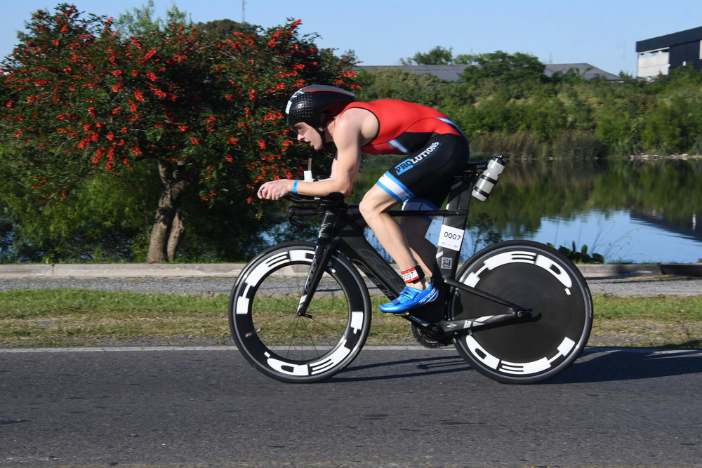 On the bike at Ironman 70.3 Buenos Aires, photo by finisher pix.