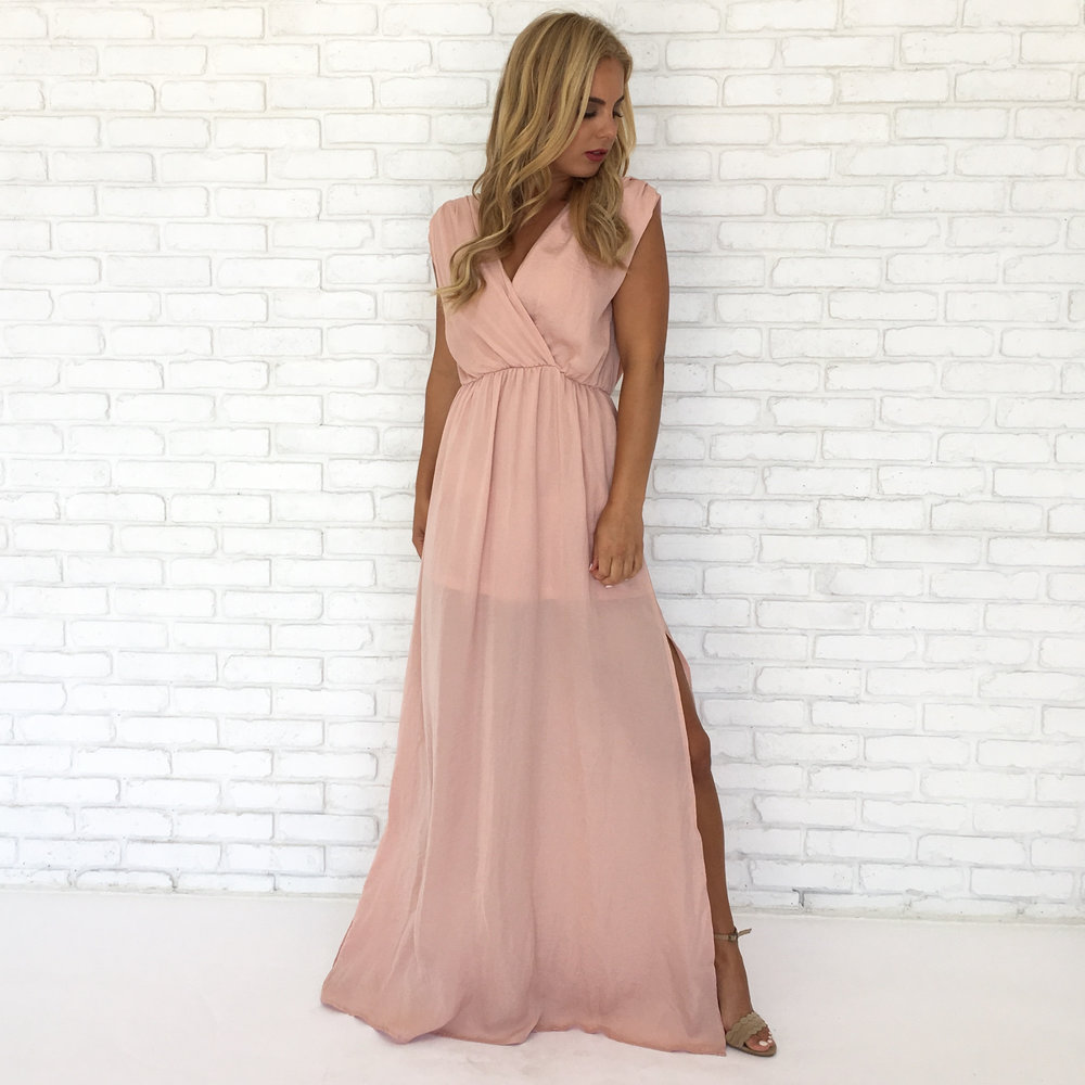 This dress is so subtle, yet stunning!  Find this dress  here !