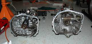 On the Left a Push style transmission (Clutch fork pushes toward bellhousing) On the Right a Pull style transmission (Clutch fork pulls toward the tail end of the transmission)