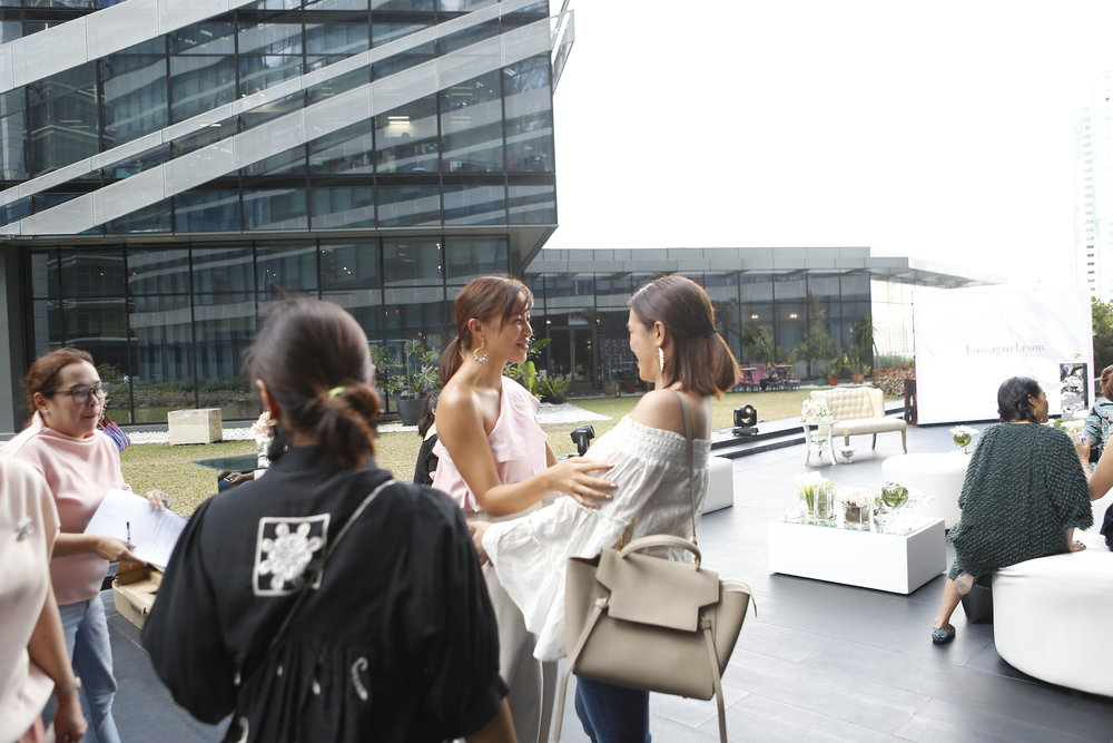 Welcoming the beautiful Nikki Gil amidst the backdrop of tall glass buildings. <3