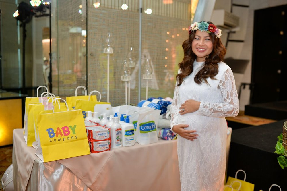 Posing by these Baby Company, Pigeon Baby, and Cetaphil products which turned out to be prizes for the games! Our guests were so happy!