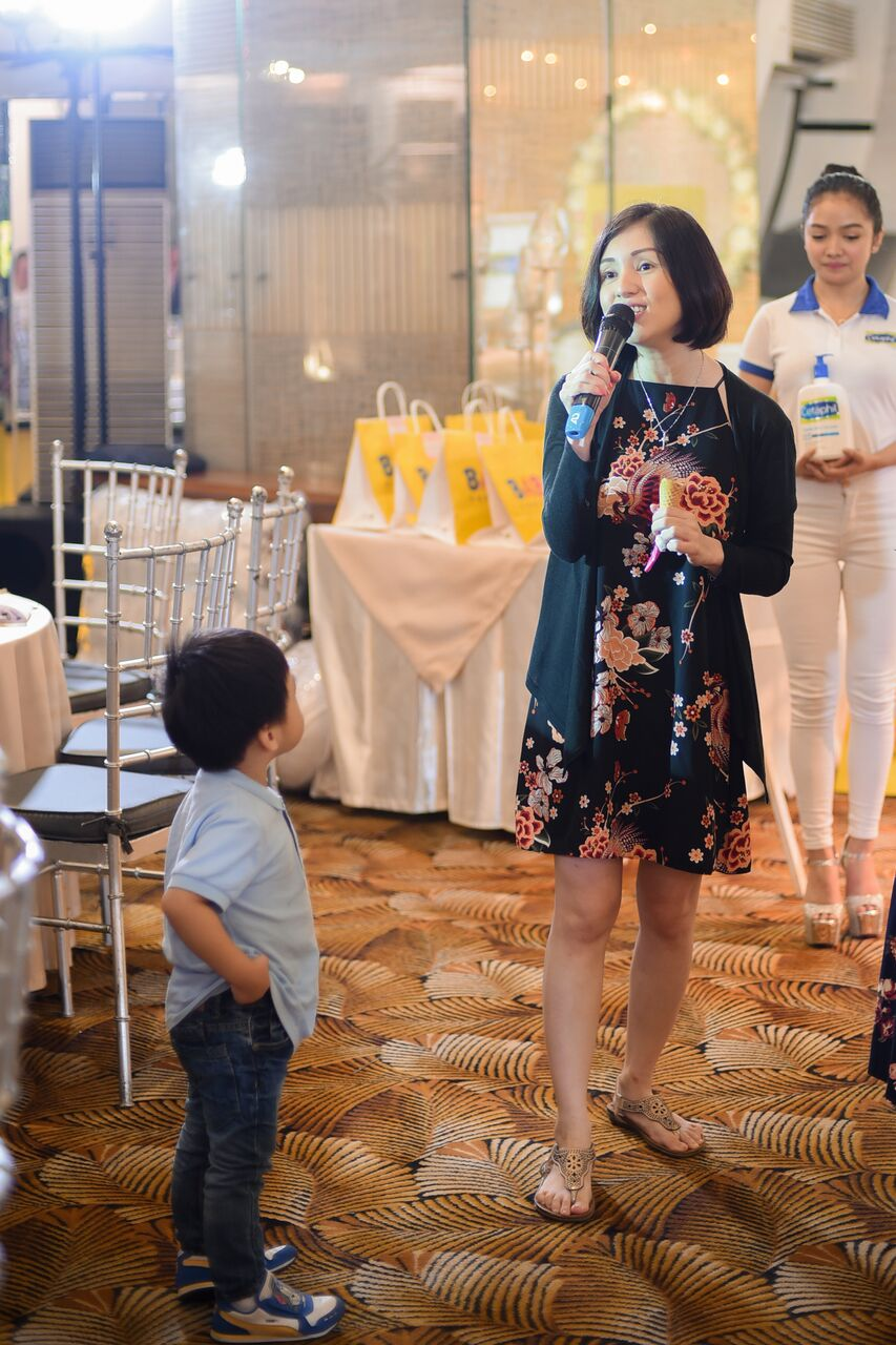 My ever beautiful friend Princess Velasco-Rosario rendering a few lines of With a Smile at the Bring Me game, while her son Kobe looks on adoringly. <3