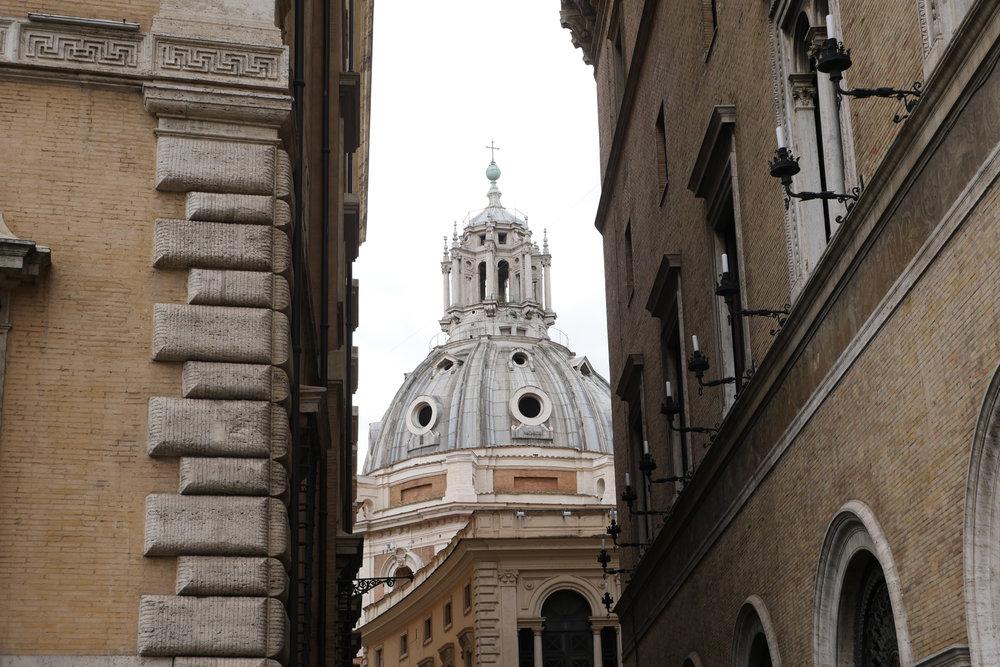 Church-dome-through-buildings-Rome.jpg