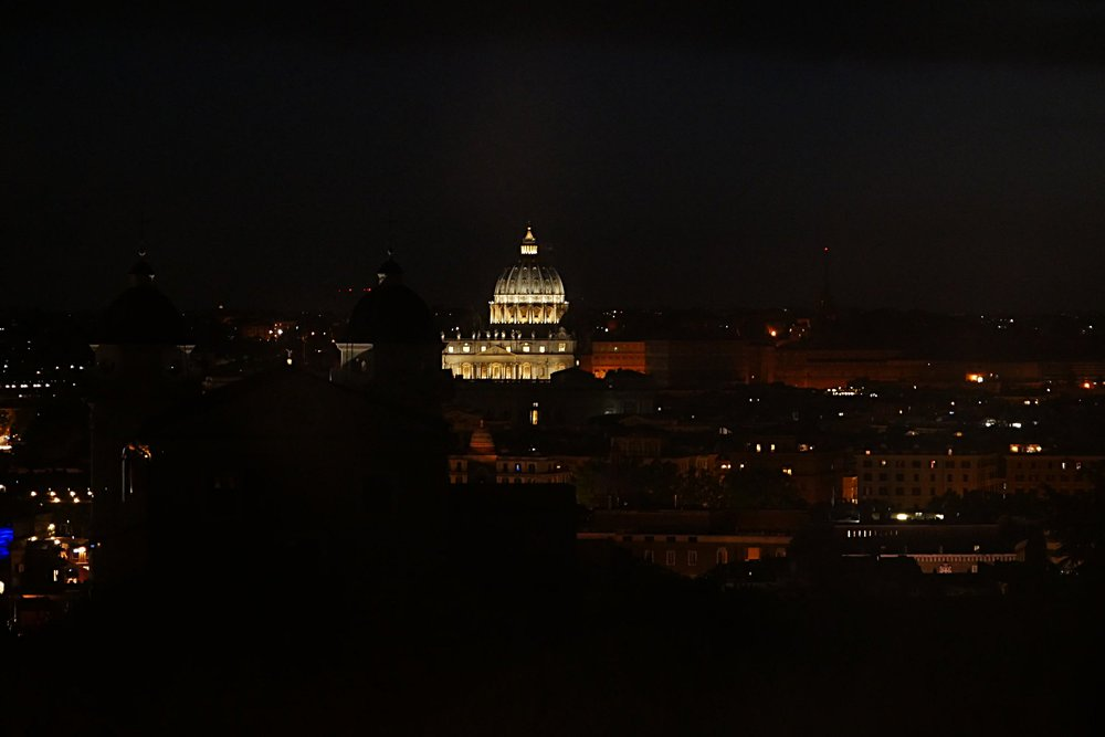 St-Peter's-Basilica-rooftop-at-night-Rome.JPG