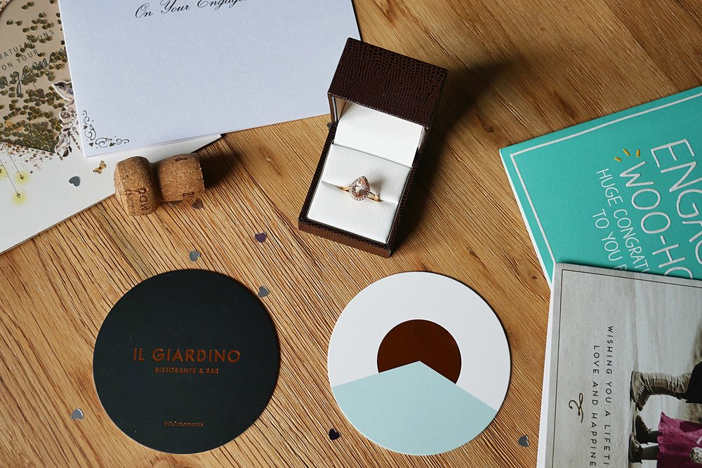 Engagement-ring-cards-champagne-corks.jpg