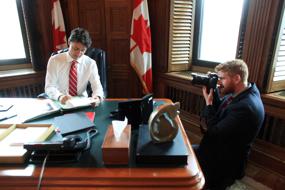 Adam Scotti, official photographer to Prime Minister Justin Trudeau takes photographs of the Prime Minister in his office on Parliament Hill June 28, 2016 in Ottawa.  DAVE CHAN FOR THE GLOBE AND MAIL