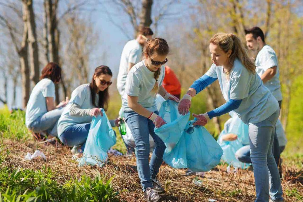 volunteers-with-garbage-bags-cleaning-park-area-540095978_5614x3743_preview copy.jpg
