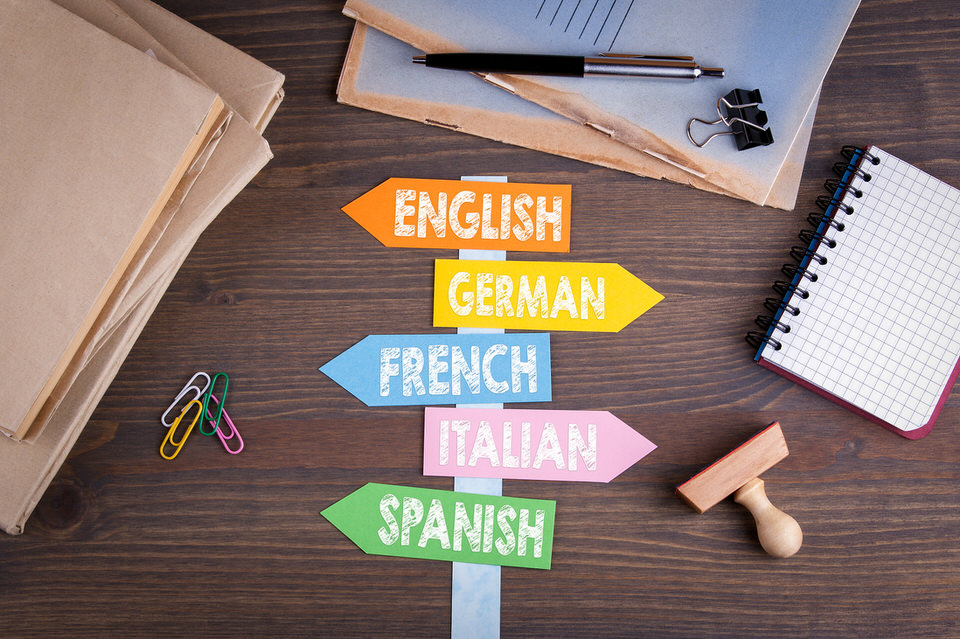 languages-concept,-English,-Italian,-German,-French,-Spanish.-Paper-signpost-on-a-wooden-desk-696445496_1258x838.jpeg