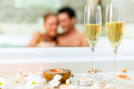 couple-tub-champagne-candle lumiere skin health & wellness centre, downtown vancouver