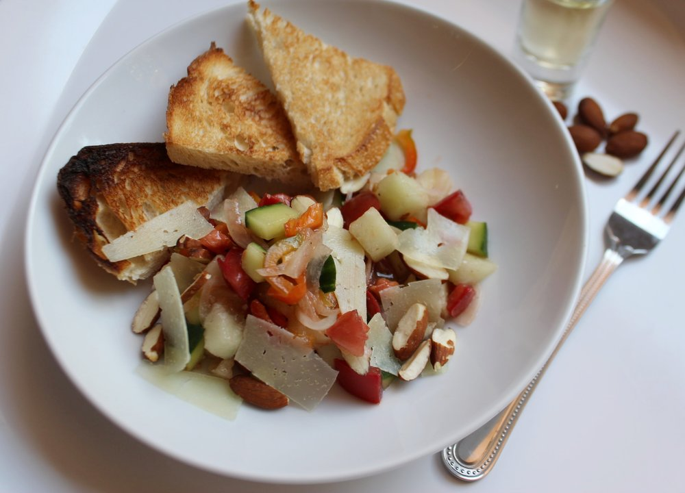 Serve the Manchego either shaved over the salad or in thin slices with the bread, heaping the salad on top of the bread and cheese. And of course, sop up every last drop of the juices with the toast as well.